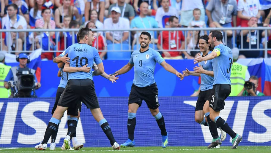 SAMARA, RUSSIA - JUNE 25: Sebastian Coates, Luis Suarez, Edinson Cavani, Diego Godin of Uruguay celebrate scoring a goal during the 2018 FIFA World Cup Russia group A match between Uruguay and Russia at Samara Arena on June 25, 2018 in Samara, Russia. (Photo by Lukasz Laskowski/PressFocus/MB Media/Getty Images)