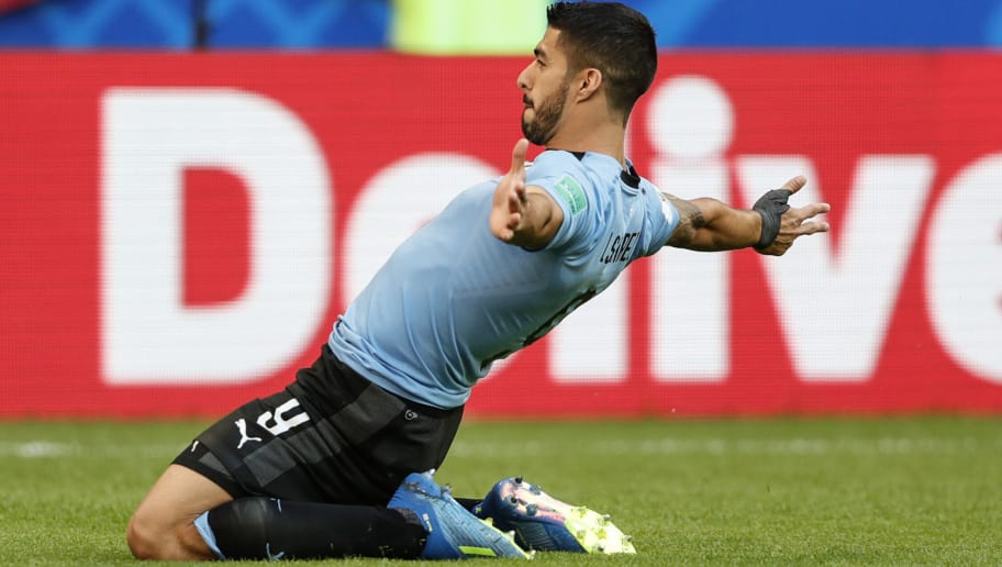 SAMARA, RUSSIA - JUNE 25:  Luis Suarez of Uruguay celebrates scoring a goal during the 2018 FIFA World Cup Russia group A match between Uruguay and Russia at Samara Arena on June 25, 2018 in Samara, Russia.  (Photo by Fred Lee/Getty Images)