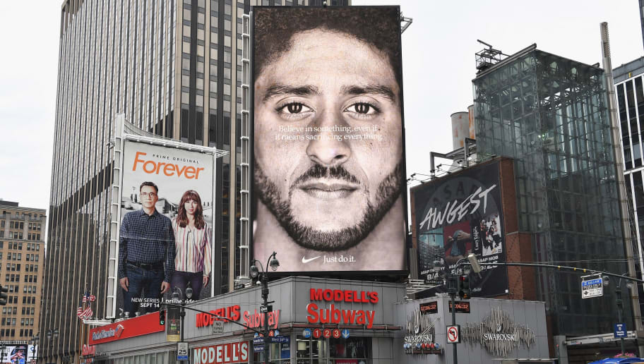 A Nike Ad featuring American football quarterback  Colin Kaepernick is on diplay September 8, 2018 in New York City. - Nike's new ad campaign featuring Kaepernick, the American football player turned activist against police violence, takes a strong stance on a divisive issue which could score points with millennials but risks alienating conservative customers. The ads prompted immediate calls for Nike boycotts over Kaepernick, who has been castigated by US President Donald Trump and other conservatives over his kneeling protests during the playing of the US national anthem. (Photo by Angela Weiss / AFP)        (Photo credit should read ANGELA WEISS/AFP/Getty Images)