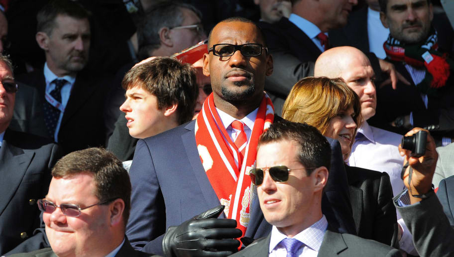 "US basketball player Lebron James (C), a minority owner at Anfield, looks on before the English Premier League football match between Liverpool and Manchester United at Anfield in Liverpool, north-west England on October 15, 2011. AFP PHOTO/ANDREW YATES  RESTRICTED TO EDITORIAL USE. No use with unauthorized audio, video, data, fixture lists, club/league logos or ""live"" services. Online in-match use limited to 45 images, no video emulation. No use in betting, games or single club/league/player publications. (Photo credit should read ANDREW YATES/AFP/Getty Images)"