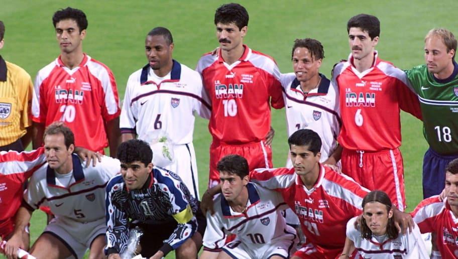USA ans Iran's teams pose together 21 Ju