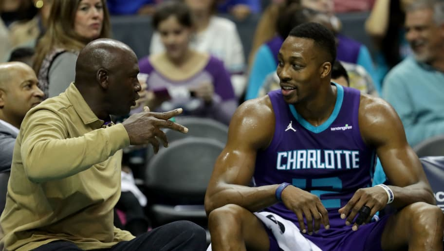CHARLOTTE, NC - JANUARY 12:  (L-R) Michael Jordan, owner of the Charlotte Hornets, talks to Dwight Howard #12 of the Charlotte Hornets during their game against the Utah Jazz at Spectrum Center on January 12, 2018 in Charlotte, North Carolina.  NOTE TO USER: User expressly acknowledges and agrees that, by downloading and or using this photograph, User is consenting to the terms and conditions of the Getty Images License Agreement.  (Photo by Streeter Lecka/Getty Images)