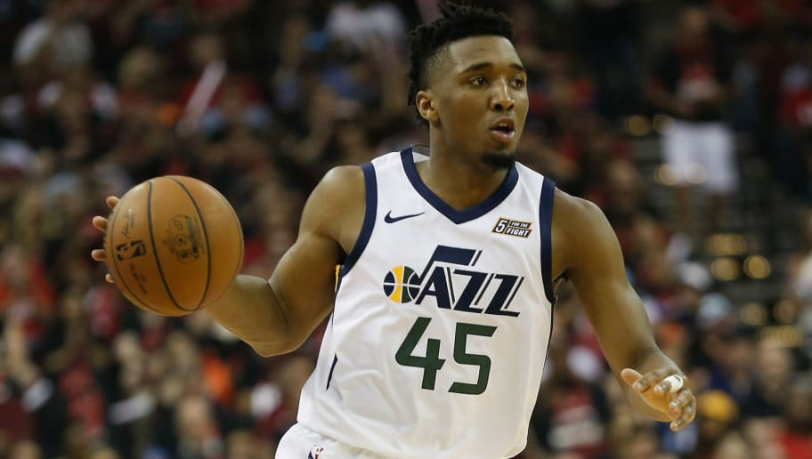 HOUSTON, TX - MAY 08:  Donovan Mitchell #45 of the Utah Jazz brings the ball up the court against the Houston Rockets during Game Five of the Western Conference Semifinals of the 2018 NBA Playoffs at Toyota Center on May 8, 2018 in Houston, Texas.  NOTE TO USER: User expressly acknowledges and agrees that, by downloading and or using this photograph, User is consenting to the terms and conditions of the Getty Images License Agreement.  (Photo by Bob Levey/Getty Images)