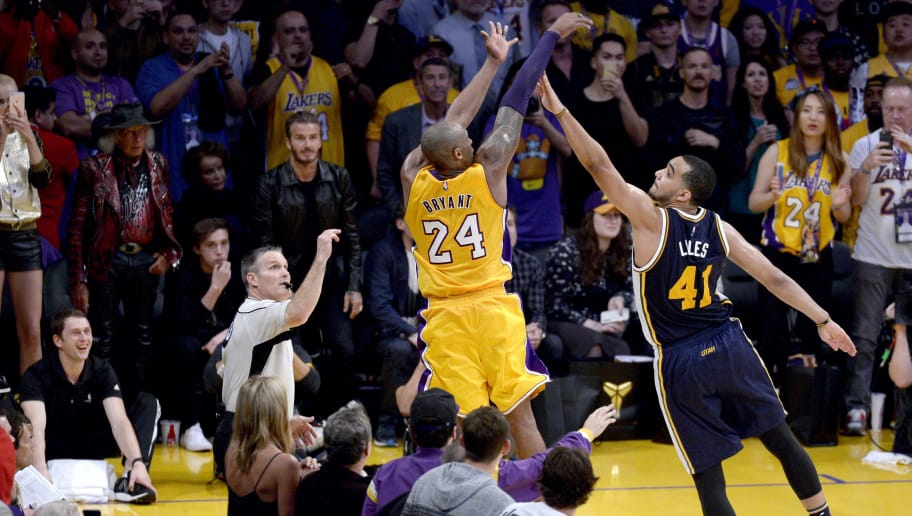 Kobe Bryant #24 of the Los Angeles Lakers shoots over Trey Lyles #41 of the Utah Jazz during the final game of his career on April 13, 2016 at Staples Center in Los Angeles, California.  (Photo by Kevork Djansezian/Getty Images)