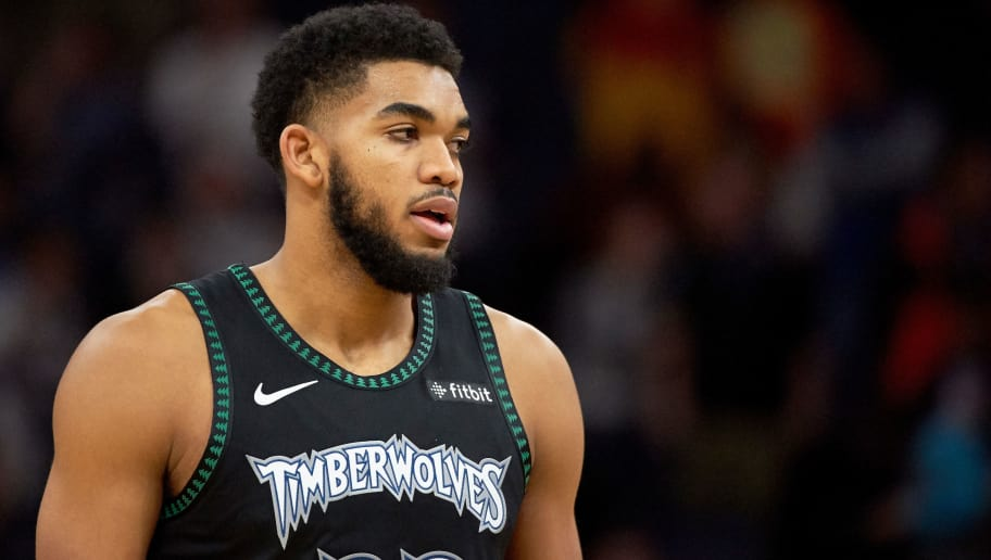 MINNEAPOLIS, MN - OCTOBER 31: Karl-Anthony Towns #32 of the Minnesota Timberwolves looks on during the game against the Utah Jazz on October 31, 2018 at the Target Center in Minneapolis, Minnesota. NOTE TO USER: User expressly acknowledges and agrees that, by downloading and or using this Photograph, user is consenting to the terms and conditions of the Getty Images License Agreement. (Photo by Hannah Foslien/Getty Images)