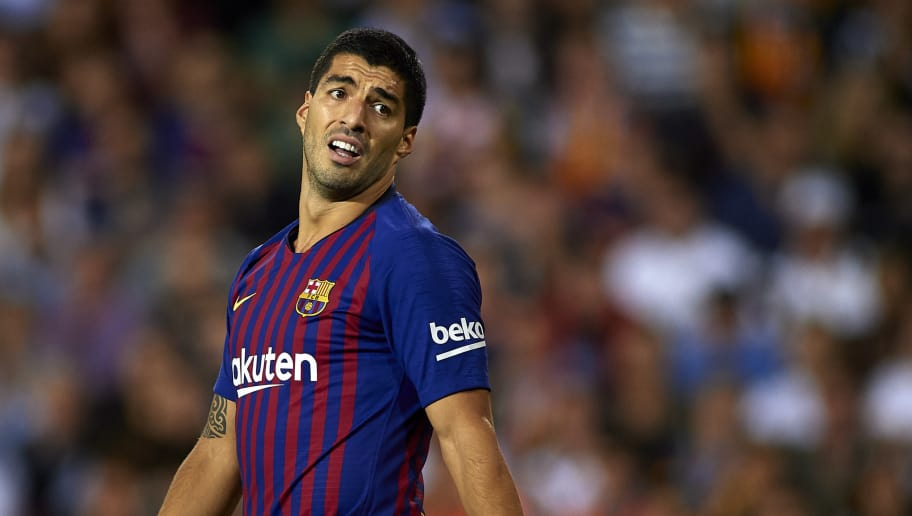 VALENCIA, SPAIN - OCTOBER 07:  Luis Suarez of Barcelona reacts during the La Liga match between Valencia CF and FC Barcelona at Estadio Mestalla on October 7, 2018 in Valencia, Spain.  (Photo by Manuel Queimadelos Alonso/Getty Images)