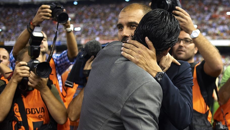 VALENCIA, SPAIN - SEPTEMBER 21:  Head Coach Josep Guardiola (R) of Barcelona embrance to Head Coach Unai Emery of Valencia before the La Liga match between Valencia and Barcelona at Estadio Mestalla on September 21, 2011 in Valencia, Spain.  (Photo by Manuel Queimadelos Alonso/Getty Images)