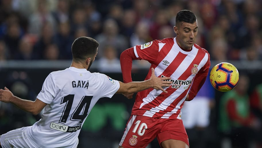 VALENCIA, SPAIN - NOVEMBER 03:  Jose Luis Gaya (L) of Valencia competes for the ball with Borja Garcia of Girona during the La Liga match between Valencia CF and Girona FC at Estadio Mestalla on November 3, 2018 in Valencia, Spain.  (Photo by Quality Sport Images/Getty Images)