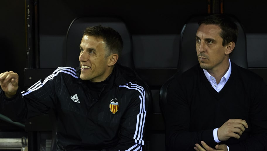 VALENCIA, SPAIN - FEBRUARY 13:  Gary Neville (R) manager of Valencia and Phil Neville assistant manager of Valencia look on prior the La Liga match between Valencia CF and RCD Espanyol at Estadi de Mestalla on February 13, 2016 in Valencia, Spain.  (Photo by Manuel Queimadelos Alonso/Getty Images)