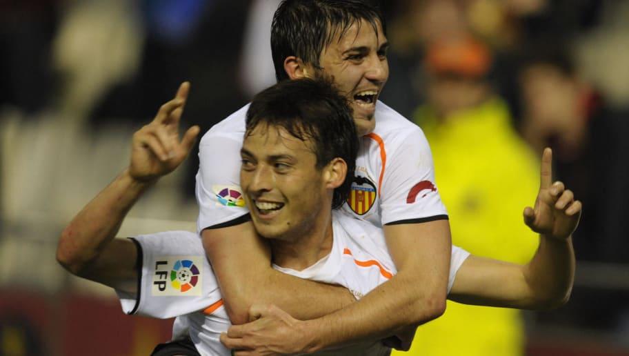 Valencia's David Silva (up) celebrates a