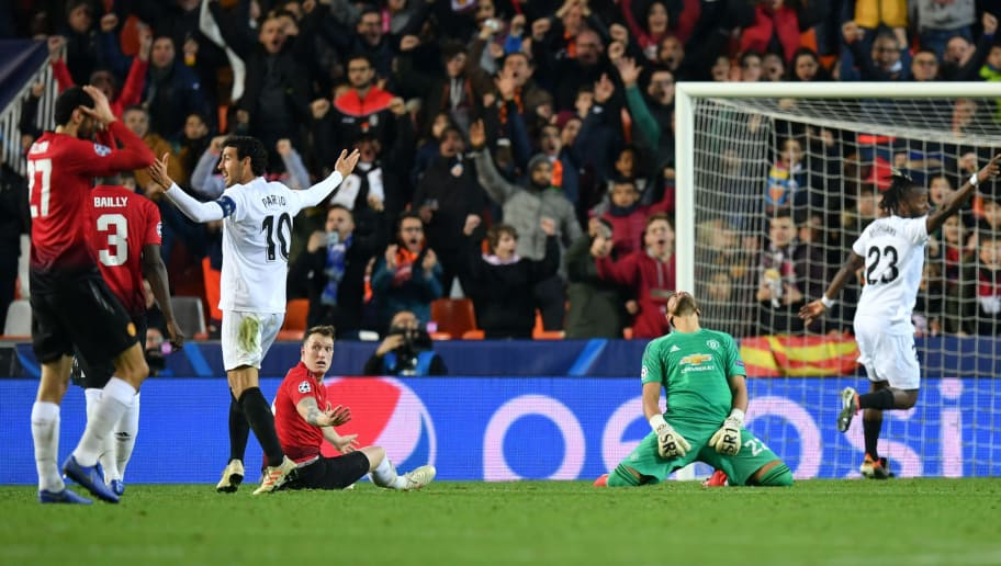 VALENCIA, SPAIN - DECEMBER 12:  Phil Jones of Manchester United reacts after he scores an own goal during the UEFA Champions League Group H match between Valencia and Manchester United at Estadio Mestalla on December 12, 2018 in Valencia, Spain.  (Photo by Dan Mullan/Getty Images)