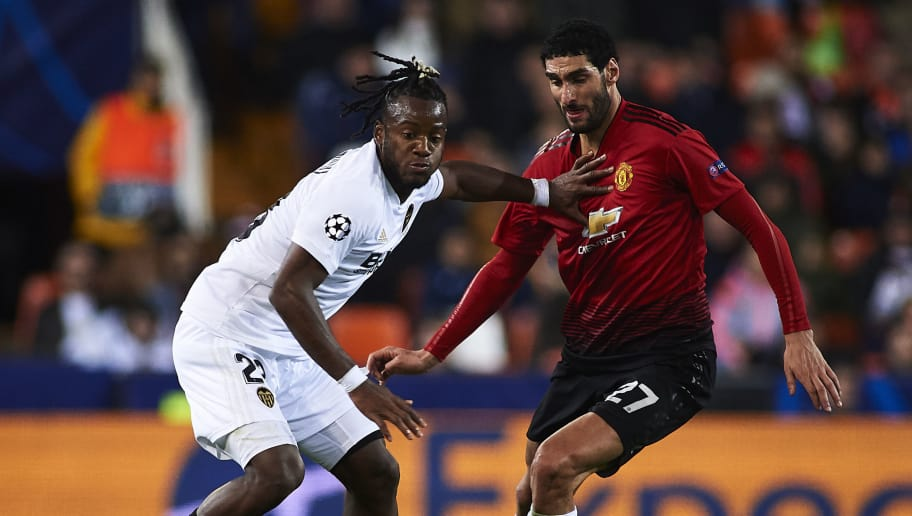 VALENCIA, SPAIN - DECEMBER 12: Michy Batshuayi of Valencia competes for the ball with Marouane Fellaini of Manchester United during the UEFA Champions League Group H match between Valencia and Manchester United at Estadio Mestalla on December 12, 2018 in Valencia, Spain. (Photo by Quality Sport Images/Getty Images)