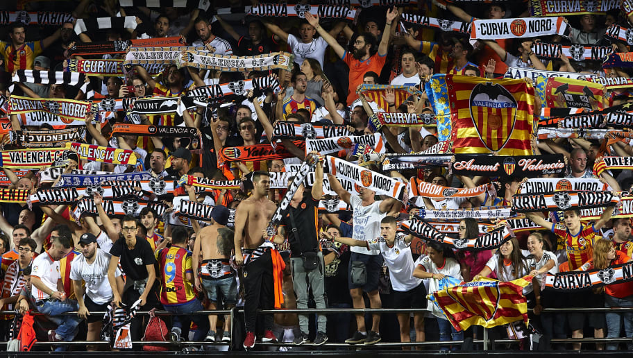 VALENCIA, SPAIN - OCTOBER 21:  Valencia fans cheer during the La Liga match between Valencia and Sevilla at Estadio Mestalla on October 21, 2017 in Valencia, Spain.  (Photo by Manuel Queimadelos Alonso/Getty Images)