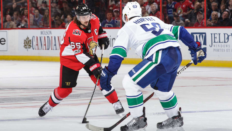 OTTAWA, ON - OCTOBER 17: Erik Karlsson #65 of the Ottawa Senators stick handles the puck against Bo Horvat #53 of the Vancouver Canucks in the second period at Canadian Tire Centre on October 17, 2017 in Ottawa, Ontario, Canada.  (Photo by Jana Chytilova/Freestyle Photography/Getty Images)