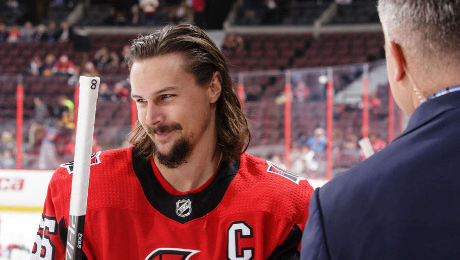 OTTAWA, ON - OCTOBER 17: Erik Karlsson #65 of the Ottawa Senators is interviewed during warm-ups prior to the start of a game against the Vancouver Canucks at Canadian Tire Centre on October 17, 2017 in Ottawa, Ontario, Canada.  (Photo by Jana Chytilova/Freestyle Photography/Getty Images)