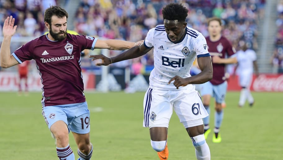 COMMERCE CITY, CO - JUNE 01: Jack Price #19 of Colorado Rapids chases Alphonso Davies #67 of Vancouver Whitecaps at Dick's Sporting Goods Park on June 1, 2018 in Commerce City, Colorado. (Photo by Timothy Nwachukwu/Getty Images)