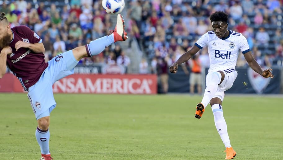 COMMERCE CITY, CO - JUNE 01: Alphonso Davies #67 of Vancouver Whitecaps attempts a pass over Enzo Martinez #90 of Colorado Rapids at Dick's Sporting Goods Park on June 1, 2018 in Commerce City, Colorado. (Photo by Timothy Nwachukwu/Getty Images)