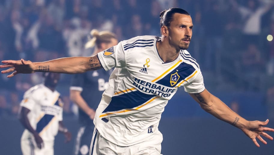 CARSON, CA - SEPTEMBER 29: Zlatan Ibrahimovic #9 of Los Angeles Galaxy celebrates his penalty kick goal during the Los Angeles Galaxy's MLS match against Vancouver Whitecaps at the StubHub Center on September 29, 2018 in Carson, California.  The Los Angeles Galaxy won the match 3-0 (Photo by Shaun Clark/Getty Images)