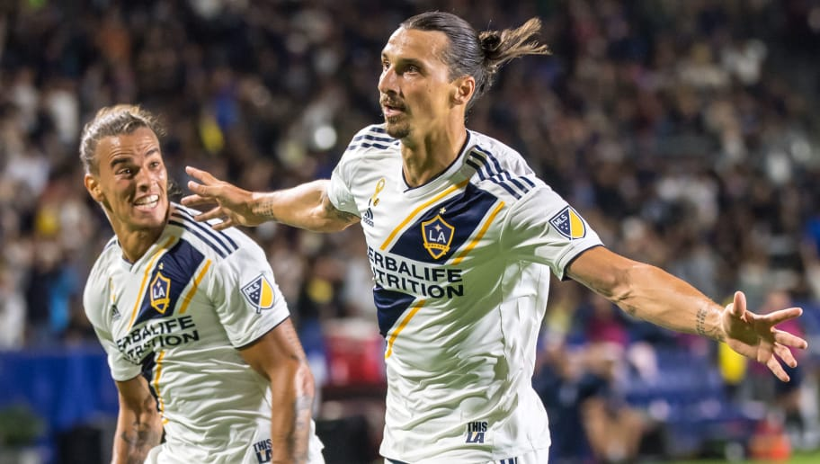 CARSON, CA - SEPTEMBER 29:  Zlatan Ibrahimovic #9 of Los Angeles Galaxy celebrates his 2nd goal with Rolf Feltscher #25 of Los Angeles Galaxy during the Los Angeles Galaxy's MLS match against Vancouver Whitecaps at the StubHub Center on September 29, 2018 in Carson, California.  The Los Angeles Galaxy won the match 3-0 (Photo by Shaun Clark/Getty Images)