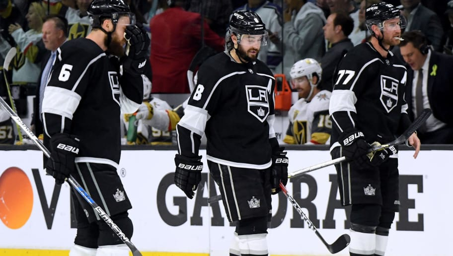 LOS ANGELES, CA - APRIL 17:  Jake Muzzin #6, Drew Doughty #8 and Jeff Carter #77 of the Los Angeles Kings skate back to the bench after a Kings's timeout trailing 1-0 to the Vegas Golden Knights with less than a minute in Game Four of the Western Conference First Round during the 2018 NHL Stanley Cup Playoffs at Staples Center on April 17, 2018 in Los Angeles, California.  The Golden Knights won 1-0 to sweep the series.  (Photo by Harry How/Getty Images)