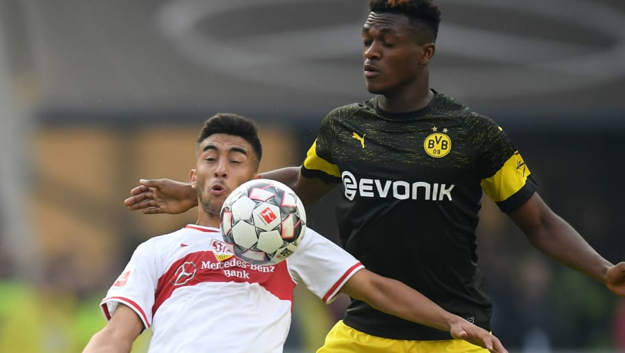 STUTTGART, GERMANY - OCTOBER 20: Nicolas Gonzalez of Stuttgart and Dan-Axel Zagadou of Dortmund compete for the ball during the Bundesliga match between VfB Stuttgart and Borussia Dortmund at Mercedes-Benz Arena on October 20, 2018 in Stuttgart, Germany. (Photo by Matthias Hangst/Bongarts/Getty Images)