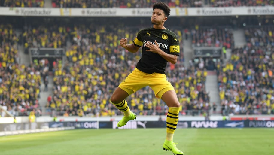 STUTTGART, GERMANY - OCTOBER 20:  Jadon Sancho of Borussia Dortmund celebrates after scoring his team's first goal during the Bundesliga match between VfB Stuttgart and Borussia Dortmund at Mercedes-Benz Arena on October 20, 2018 in Stuttgart, Germany.  (Photo by Matthias Hangst/Bongarts/Getty Images)