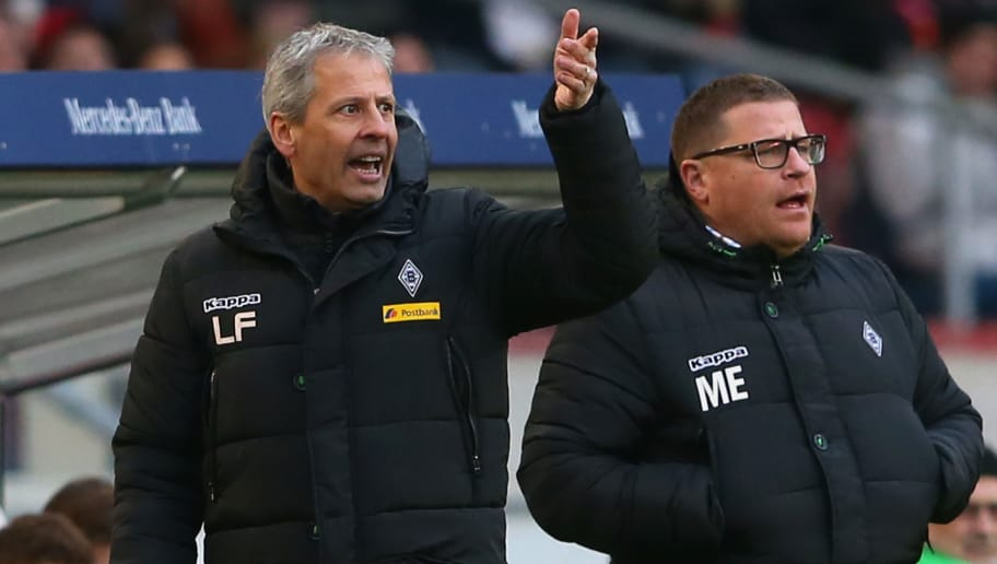 STUTTGART, GERMANY - JANUARY 31:  Lucien Favre, head coach of Gladbach reacts with Gladbach`s manager Max Eberl (R) during the Bundesliga match between VfB Stuttgart and Borussia Moenchengladbach at Mercedes-Benz Arena on January 31, 2015 in Stuttgart, Germany.  (Photo by Alexander Hassenstein/Bongarts/Getty Images)