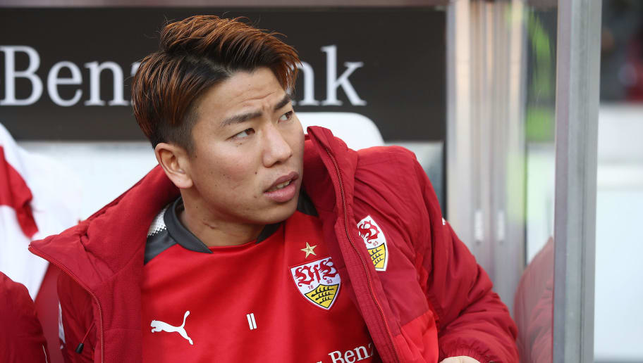 STUTTGART, GERMANY - FEBRUARY 24: Takuma Asano of Stuttgart sits on the bench and looks on before the Bundesliga match between VfB Stuttgart and Eintracht Frankfurt at Mercedes-Benz Arena on February 24, 2018 in Stuttgart, Germany. (Photo by Alex Grimm/Bongarts/Getty Images)