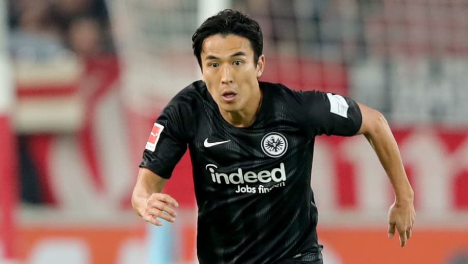 STUTTGART, GERMANY - NOVEMBER 02:  Makoto Hasebe of Frankfurt runs with the ball during the Bundesliga match between VfB Stuttgart and Eintracht Frankfurt at Mercedes-Benz Arena on November 2, 2018 in Stuttgart, Germany.  (Photo by Alexander Hassenstein/Bongarts/Getty Images)