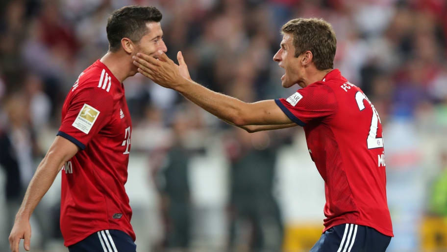STUTTGART, GERMANY - SEPTEMBER 01:  Thomas Mueller of Bayern Munich celebrates with teammate Robert Lewandowski after scoring his team's third goal during the Bundesliga match between VfB Stuttgart and FC Bayern Muenchen at Mercedes-Benz Arena on September 1, 2018 in Stuttgart, Germany.  (Photo by Alexander Hassenstein/Bongarts/Getty Images)