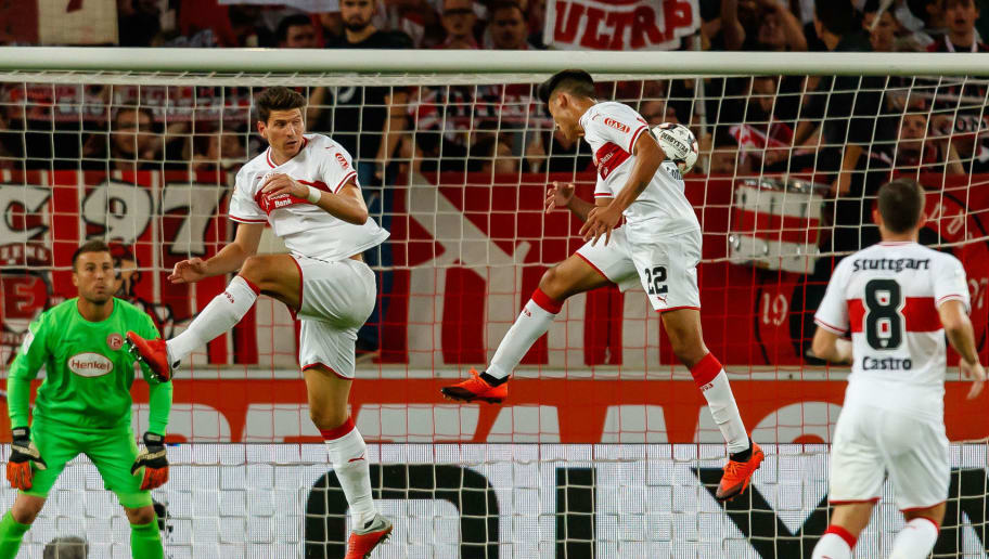 STUTTGART, GERMANY - SEPTEMBER 21: Mario Gomez Garcia of VfB Stuttgart and Nicolas Gonzalez of VfB Stuttgart controls the ball during the Bundesliga match between VfB Stuttgart and Fortuna Duesseldorf at Mercedes-Benz Arena on September 21, 2018 in Stuttgart, Germany. (Photo by TF-Images/Getty Images)