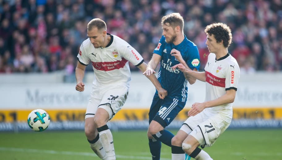 STUTTGART, GERMANY - MARCH 31: Aaron Hunt of Hamburg is challenged by Holger Badstuber of Stuttgart and Benjamin Pavard of Stuttgart (R) during the Bundesliga match between VfB Stuttgart and Hamburger SV at Mercedes-Benz Arena on March 31, 2018 in Stuttgart, Germany. (Photo by Simon Hofmann/Bongarts/Getty Images)