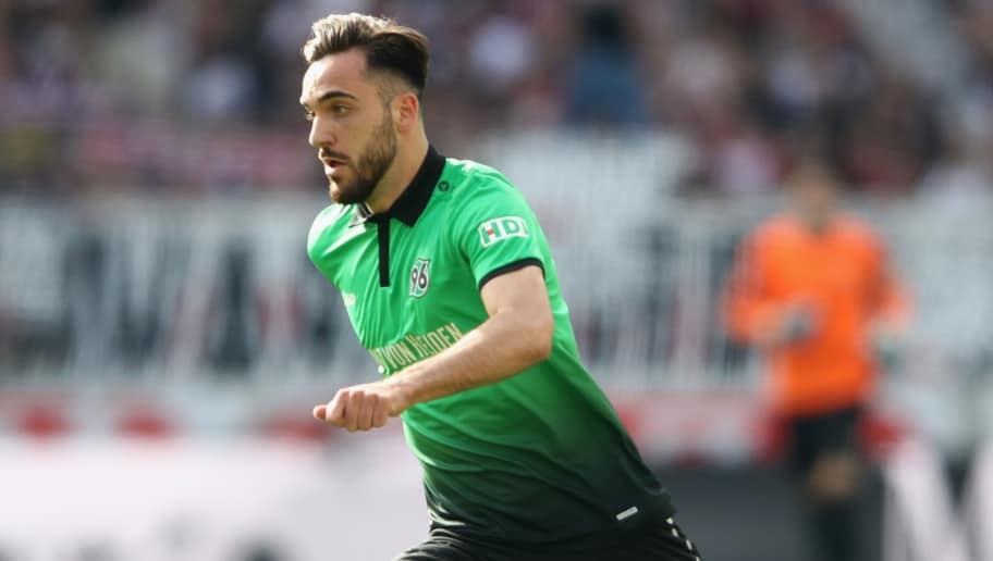 STUTTGART, GERMANY - APRIL 14:  Kenan Karaman of Hannover controls the ball during the Bundesliga match between VfB Stuttgart and Hannover 96 at Mercedes-Benz Arena on April 14, 2018 in Stuttgart, Germany.  (Photo by Alex Grimm/Bongarts/Getty Images)