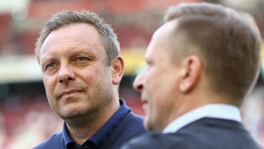 STUTTGART, GERMANY - APRIL 14: Head coach Andre Breitenreiter and sporting director Horst Heldt of Hannover look on prior to the Bundesliga match between VfB Stuttgart and Hannover 96 at Mercedes-Benz Arena on April 14, 2018 in Stuttgart, Germany.  (Photo by Alex Grimm/Bongarts/Getty Images)