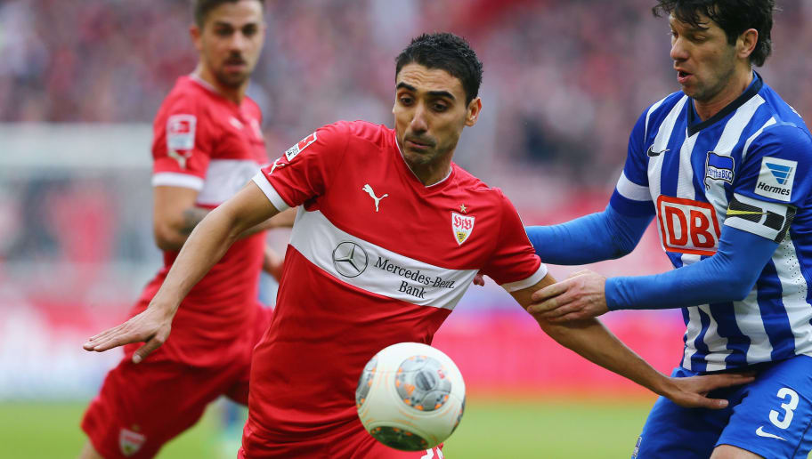 STUTTGART, GERMANY - FEBRUARY 22: Mohammed Abdellaoue (L) of Stuttgart is challenged by Levan Kobiashvili of Berlin during the Bundesliga match between VfB Stuttgart and Hertha BSC Berlin at Mercedes-Benz Arena on February 22, 2014 in Stuttgart, Germany.  (Photo by Alex Grimm/Bongarts/Getty Images)