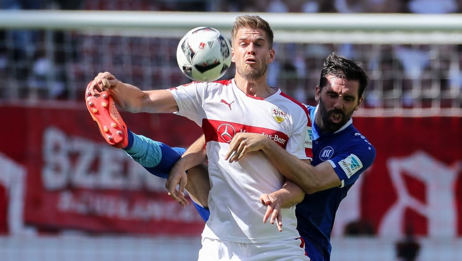STUTTGART, GERMANY - APRIL 09: Simon Terodde of Stuttgart and Jordi Figueras Montel of Karlsruher SC battle for the ball during the Second Bundesliga match between VfB Stuttgart and Karlsruher SC at Mercedes-Benz Arena on April 9, 2017 in Stuttgart. (Photo by TF-Images/Getty Images)