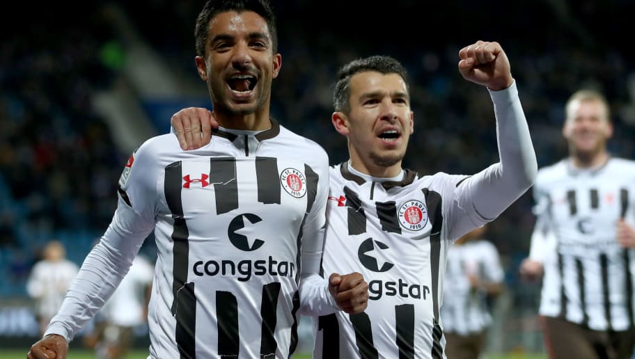 BOCHUM, GERMANY - DECEMBER 10: Sami Allagui of Pauli celebrates with team mates after scoring his teams first goal during the Second Bundesliga match between VfL Bochum 1848 and FC St. Pauli at Vonovia Ruhrstadion on December 10, 2018 in Bochum, Germany. (Photo by Lars Baron/Bongarts/Getty Images)