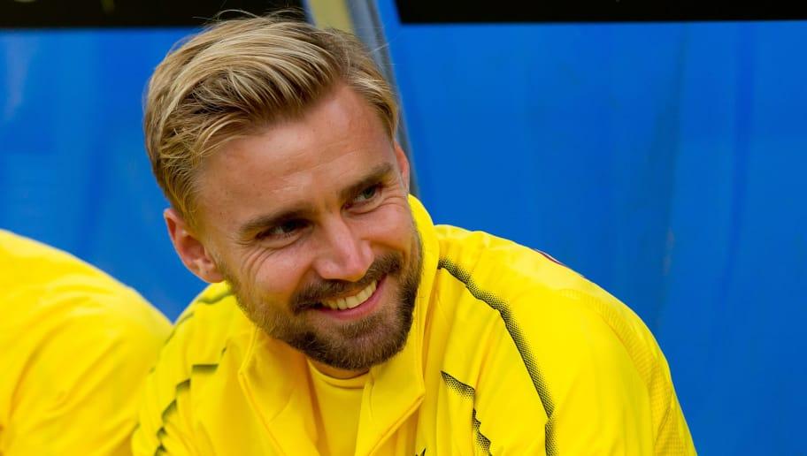 OSNABRÜCK, GERMANY - SEPTEMBER 06: Marcel Schmelzer of Borussia Dortmund laughs prior the Frendly Match between VfL Osnabrück and Borussia Dortmund at Stadion an der Bremer Brücke on September 6, 2018 in Osnabrück, Germany. (Photo by TF-Images/Getty Images)