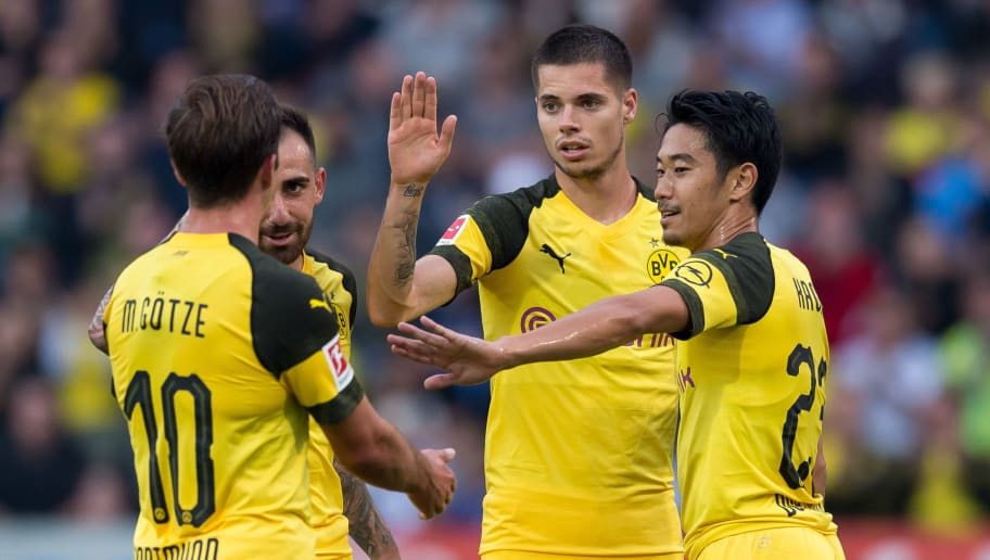OSNABRÜCK, GERMANY - SEPTEMBER 06: Mario Goetze of Borussia Dortmund , Paco Alcacer of Borussia Dortmund Julian Weigl of Borussia Dortmund and Shinji Kagawa of Borussia Dortmund celebrates a goal during the Frendly Match between VfL Osnabrück and Borussia Dortmund at Stadion an der Bremer Brücke on September 6, 2018 in Osnabrück, Germany. (Photo by TF-Images/Getty Images)