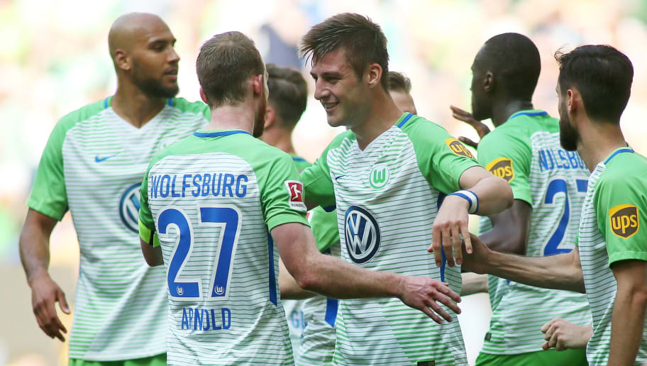 WOLFSBURG, GERMANY - MAY 12: Robin Knoche (M) of Wolfsburg celebrate their teams third scoring during the Bundesliga match between VfL Wolfsburg and 1. FC Koeln at Volkswagen Arena on May 12, 2018 in Wolfsburg, Germany. (Photo by Selim Sudheimer/Bongarts/Getty Images)