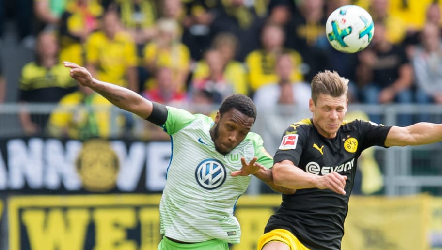 WOLFSBURG, GERMANY - AUGUST 19: Kaylen Hinds of Wolfsburg and Lukasz Piszczek of Dortmund battle for the ball during to the Bundesliga match between VfL Wolfsburg and Borussia Dortmund at Volkswagen Arena on August 19, 2017 in Wolfsburg, Germany. (Photo by TF-Images/TF-Images via Getty Images)