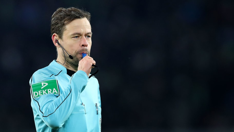 WOLFSBURG, GERMANY - JANUARY 20: Referee Markus Schmidt blows the whistle during the Bundesliga match between VfL Wolfsburg and Eintracht Frankfurt at Volkswagen Arena on January 20, 2018 in Wolfsburg, Germany. (Photo by Ronny Hartmann/Bongarts/Getty Images)