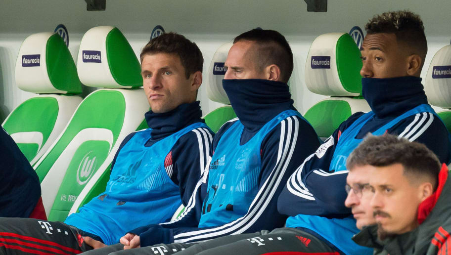 WOLFSBURG, GERMANY - OCTOBER 20: Thomas Mueller of Bayern Muenchen, Franck Ribery of Bayern Muenchen and Jerome Boateng of Bayern Muenchen sit on the bench during the Bundesliga match between VfL Wolfsburg and FC Bayern Muenchen at Volkswagen Arena on October 20, 2018 in Wolfsburg, Germany. (Photo by TF-Images/Getty Images)