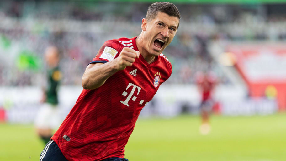 WOLFSBURG, GERMANY - OCTOBER 20: Robert Lewandowski of FC Bayern Muenchen celebrates after scoring his team's first goal during the Bundesliga match between VfL Wolfsburg and FC Bayern Muenchen at Volkswagen Arena on October 20, 2018 in Wolfsburg, Germany. (Photo by Boris Streubel/Getty Images)