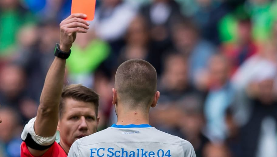 WOLFSBURG, GERMANY - AUGUST 25: Referee Patrick Ittrich show Matija Nastasic of Schalke the red card during the Bundesliga match between VfL Wolfsburg and FC Schalke 04 at Volkswagen Arena on August 25, 2018 in Wolfsburg, Germany. (Photo by TF-Images/Getty Images)