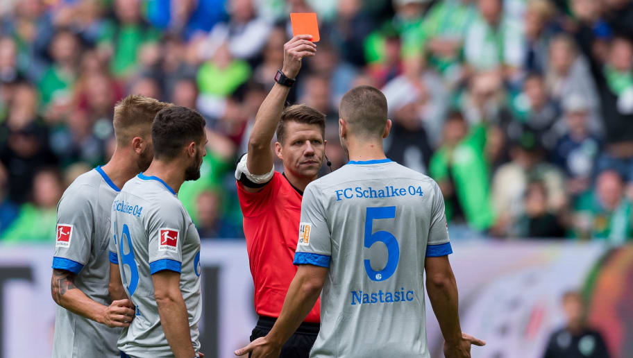 WOLFSBURG, GERMANY - AUGUST 25: Referee Patrick Ittrich shows a red card to Matija Nastasic of FC Schalke during the Bundesliga match between VfL Wolfsburg and FC Schalke 04 at Volkswagen Arena on August 25, 2018 in Wolfsburg, Germany. (Photo by TF-Images/Getty Images)