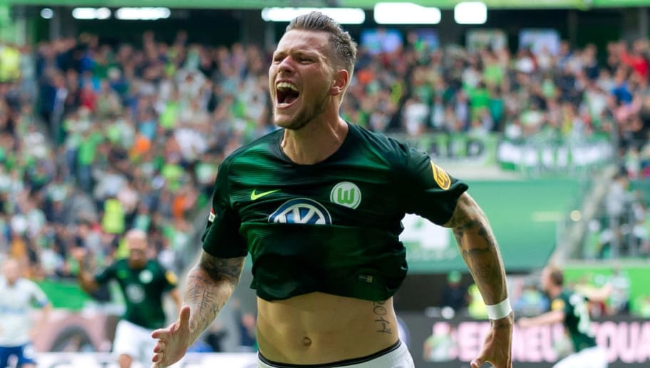 WOLFSBURG, GERMANY - AUGUST 25: Daniel Ginczek of Wolfsburg celebrates after scoring his team`s second goal during the Bundesliga match between VfL Wolfsburg and FC Schalke 04 at Volkswagen Arena on August 25, 2018 in Wolfsburg, Germany. (Photo by TF-Images/Getty Images)