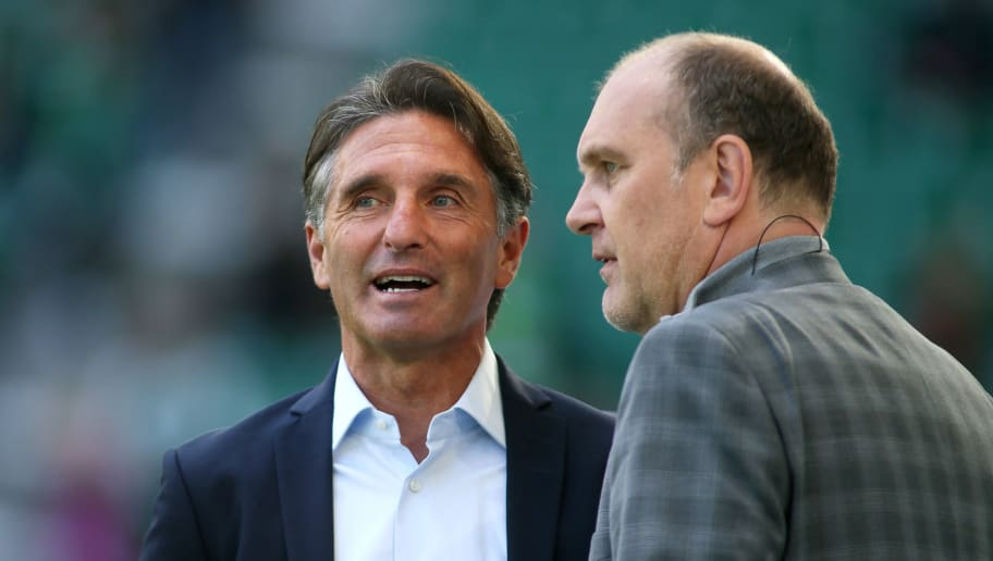 WOLFSBURG, GERMANY - AUGUST 25: Manager Joerg Schmadtke (R) and Headcoach Bruno Labbadia of Wolfsburg are seen prior the Bundesliga match between VfL Wolfsburg and FC Schalke 04 at Volkswagen Arena on August 25, 2018 in Wolfsburg, Germany. (Photo by Selim Sudheimer/Bongarts/Getty Images)