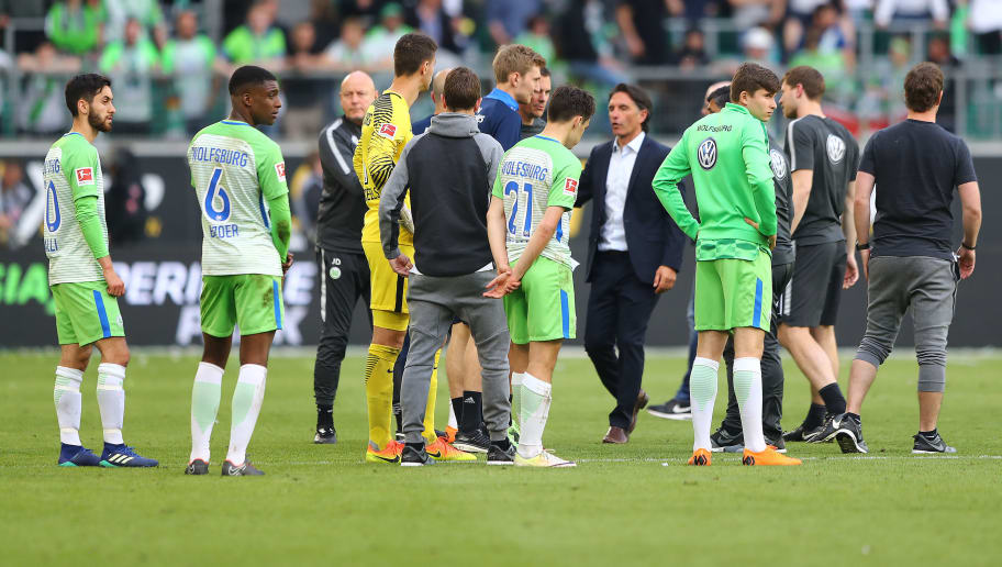 WOLFSBURG, GERMANY - APRIL 28: Players of Wolfsburg look dejected after the Bundesliga match between VfL Wolfsburg and Hamburger SV at Volkswagen Arena on April 28, 2018 in Wolfsburg, Germany. (Photo by Martin Rose/Bongarts/Getty Images)