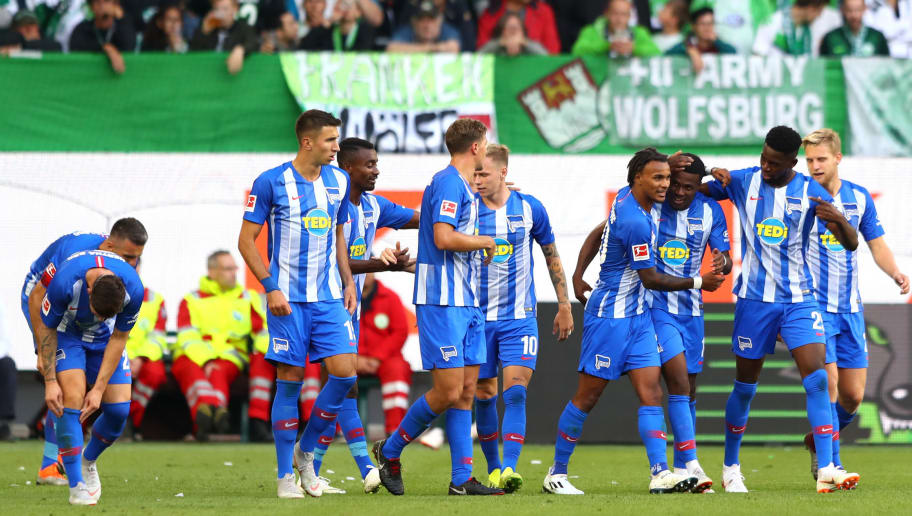 WOLFSBURG, GERMANY - SEPTEMBER 15:  Javairo Dilrosun of Hertha BSC celebrates with teammates after scoring his team's first goal during the Bundesliga match between VfL Wolfsburg and Hertha BSC at Volkswagen Arena on September 15, 2018 in Wolfsburg, Germany.  (Photo by Martin Rose/Bongarts/Getty Images)